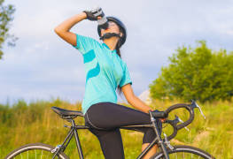 Nice Portrait Of Young Female Cyclist Athlete Having A Break.